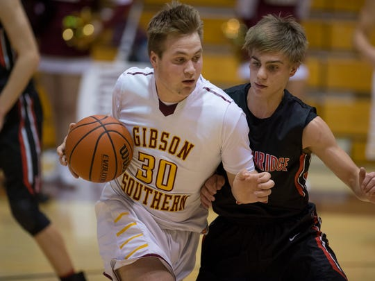 Southridge's Joe LaGrange (20) defends Gibson Southern's Nicholas Maurer (30) during their game at Gibson Southern on Feb. 1, 2018.
