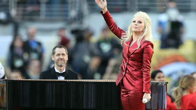 Lady Gaga performs the national anthem before Super Bowl 50 between the Carolina Panthers and the Denver Broncos at Levi's Stadium.