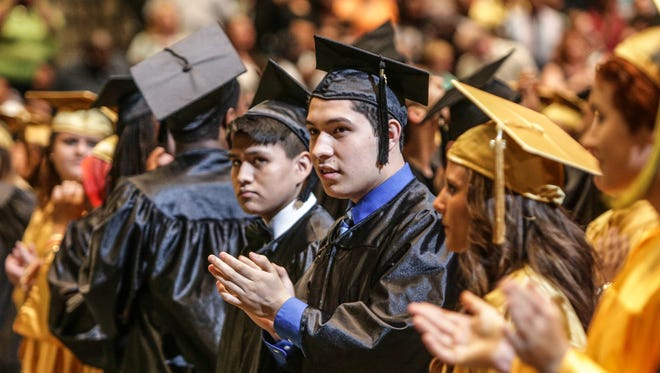 Warren Central High School students are seen at graduation ceremonies at Banker's Life Fieldhouse in Indianapolis on June 4, 2014.