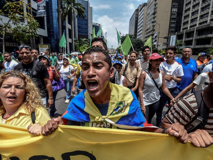 Anti-government protesters block a highway in Caracas,