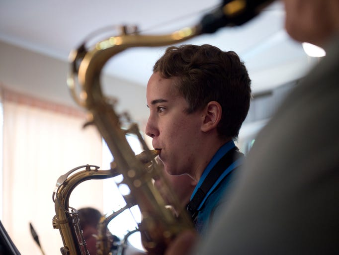 Matthew Roberts, 14, of Stuart, plays a tenor saxophone