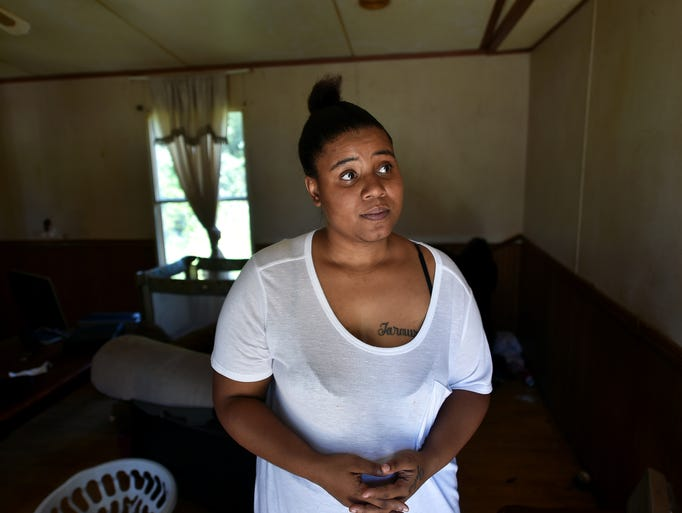 Dolecia Cody stands inside the home she and her children