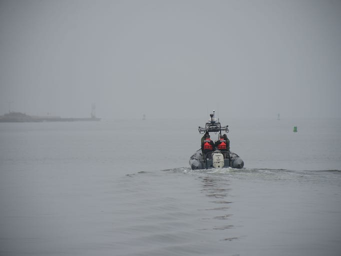 A Maryland Natural Resource Police exits a harbor in