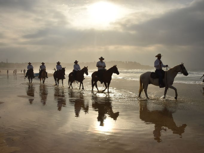 Cattlemen and women, known as drovers, ride on horseback