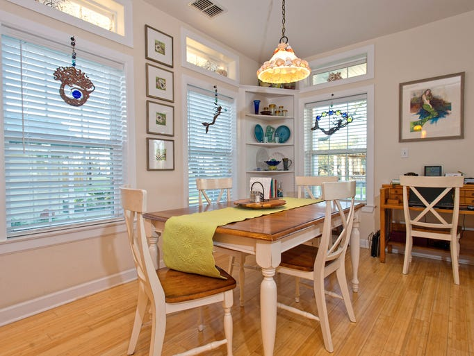 The wood floored dining space, open to the living and