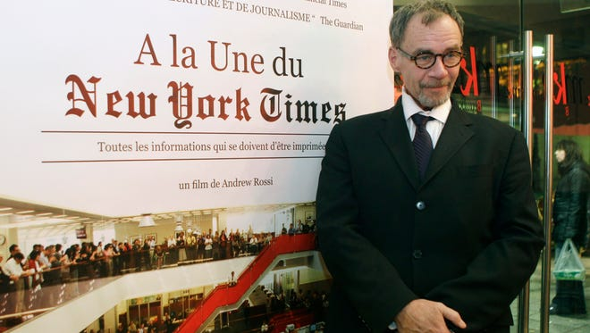 """New York Times journalist David Carr poses for a photograph as he arrives for the French premiere of the documentary """"Page One: A Year Inside The New York Times,"""" in Paris, Monday, Nov. 21, 2011. (AP Photo/Michel Euler)"""