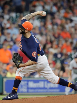 Houston Astros starting pitcher Mike Fiers throws against the Minnesota Twins during the first inning of a baseball game Sunday, July 16, 2017, in Houston.