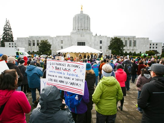 Hundreds gathered at an immigration rights rally in front of the Capitol on Sunday, Feb. 19, 2017, in Salem, Ore. Originally a march had been planned, but organizers were unable to get a permit after more than 1,500 people RSVP'd to the event.