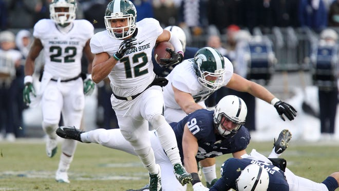 MSU's R.J. Shelton (12) runs the opening kickoff back 90 yards for a touchdown against Penn State during the Spartans' 34-10 victory on Nov. 29, 2014 in University Park, Pa.