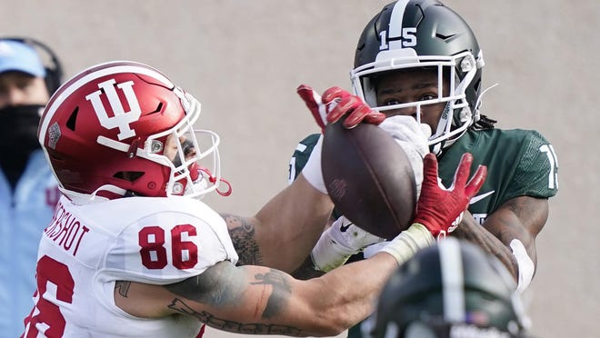 Indiana tight end Peyton Hendershot (86), defended by Michigan State cornerback Angelo Grose makes a catch during the first half of an NCAA college football game, Saturday, Nov. 14, 2020, in East Lansing, Mich.