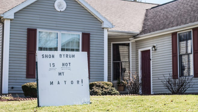 A sign reading 'Shon Byrum is not my mayor' sits in the front yard of a home along South Meridian Street in Winchester, Indiana on Tuesday, March 6, 2018.