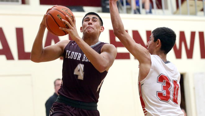 Flour Bluff's Brendan Suckley takes the ball to the basket against Incarnate Word's Jesse Mierles during the Calallen Christmas Classic on Wednesday, Dec. 28, 2016, at Calallen HIgh School in Corpus Christi.