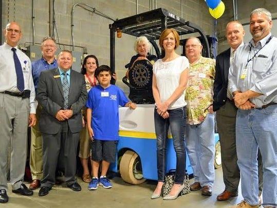 From left, are James Wissler, Mike Hockenberry, Merle Zehr, Brandy Nell and son Wesley, Peg Sennett, Kelly Rebert, John Gerken, Mark Riggs and Rotary Club President Doug Barmoy.
