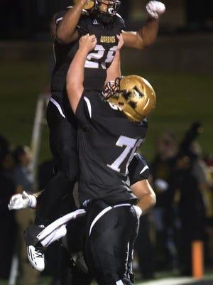Nellie Doneva/Abilene Reporter-News Abilene High's Abram Smith (28) and Jayton Voss (76) celebrate a touchdown against Midland High on Sept. 2 at Shotwell Stadium.