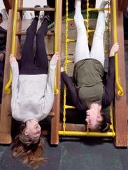 Allyson Jahn (left) and Kaia Lofy invert on a play