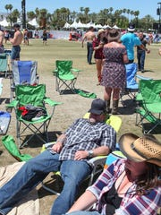 Apr 28, 2017; Indio, CA, USA; A man takes a break in the sun just after the gates opened to the Stagecoach Country Music Festival at Empire Polo Club. Mandatory Credit: The Desert Sun-USA TODAY NETWORK