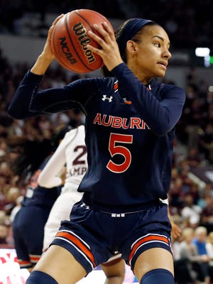 Auburn guard Emari Jones (5) pulls down a rebound against Mississippi State during the first half of an NCAA college basketball game in Starkville, Miss., Thursday, Feb. 22, 2018. (AP Photo/Rogelio V. Solis)