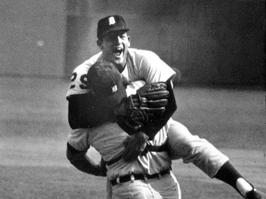 Tigers pitcher Mickey Lolich leaps into the grasp of Bill Freehan after the Tiger catcher hauled in the final out in St. Louis, to give the Tigers the 1968 World Series title over the Cardinals, Thursday, Oct. 10, 1968.