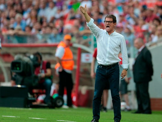 in this Sunday, June 14, 2015 file photo Russia's team coach Fabio Capello gives directions to his players during the Euro 2016 qualifying soccer match between Russia and Austria, in Moscow, Russia. Capello, former AC Milan, Real Madrid, Roma and Juventus coach has announced Monday April 9, 2018  his retirement from coaching and that he's not interested in the open job with Italy's national team. (AP Photo/Ivan Sekretarev, File)
