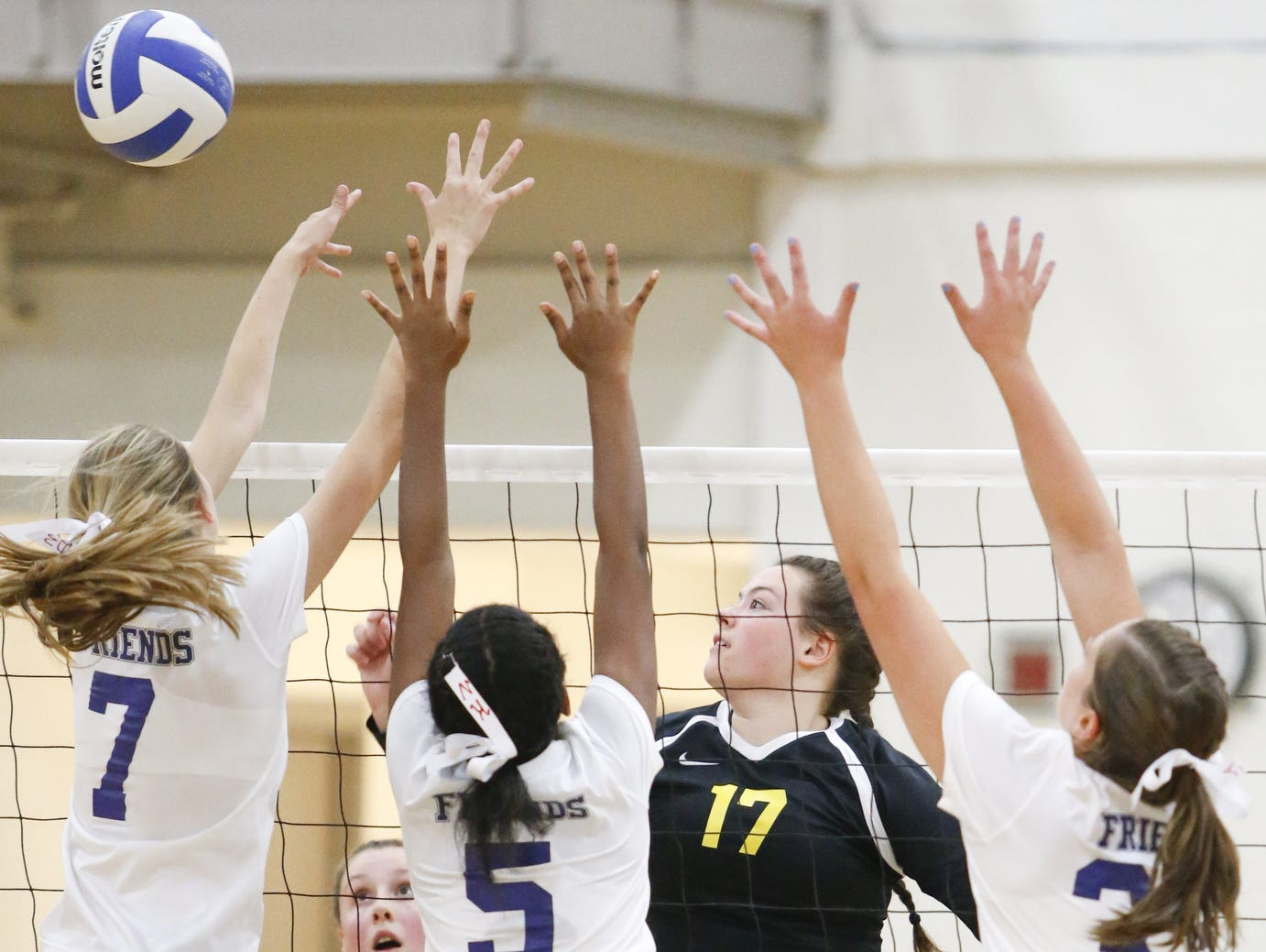 Padua's Gabriella Walsh (17) hits over the Wilmington Friends defense in the second game of Padua's 3-0 win at Wilmington Friends on Thursday.