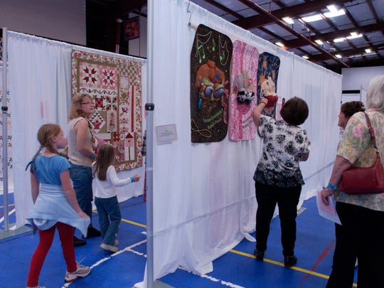 Visitors take in the Best of the Valley Quilt Show