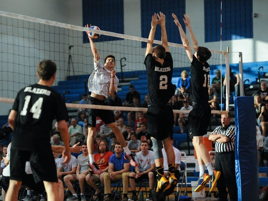 Hempfield's Logan Smiley strikes a kill attempt in front of Lancaster Mennonite's Jarred Sands and Andrew Baak. The Black Knights defeated the Blazers 3-0 to advance to the LL League Championship. Patrick Blain for GameTimePA.com
