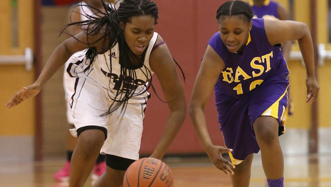 Edison's Taajah Smith, left, steals the ball from East's Cierra Nibblins.  The tournament finals will be held Saturday at 2:15.