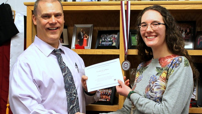 National Merit Scholarship finalist Tallulah Keeley-LeClaire is congratulated by Elmira High School Principal Christopher Krantz.