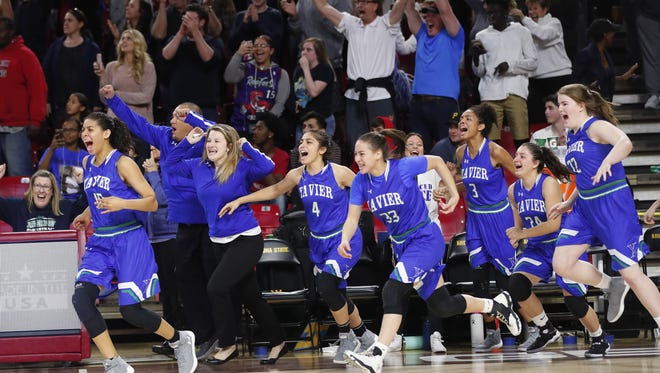 Xavier players celebrate after beating Millennium in the 6A girls basketball semifinal at Wells Fargo Arena in Tempe, Ariz. February 21, 2018.