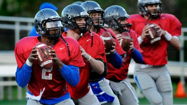 Faulkner's quarterbacks, including Terrell Robinson (2), warm up before the spring football game Tuesday night. See more photos at montgomeryadvertiser.com.