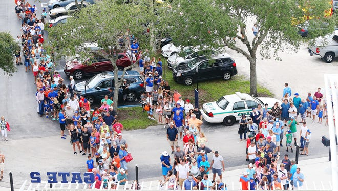 Fans wait outside Hammond Stadium on Friday for the game between the Fort Myers Miracle and St. Lucie Mets at Hammond Stadium in Fort Myers. Former University of Florida quarterback Tim Tebow plays for St. Lucie.