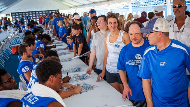 People line up for autographs at MTSU's annual Fan Day last year.