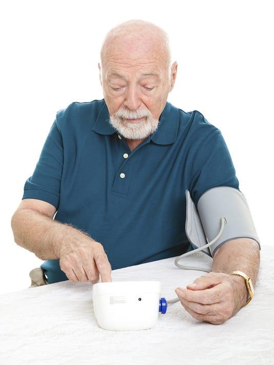 older guy checking bp.jpg