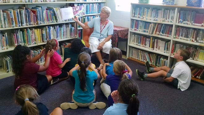 Elementary students at Cumberland Christian School in Vineland joined librarian Sherri Torrance's for a story about God's love.  For school information, call (856) 696-1600 or visit www.cccrusader.org.