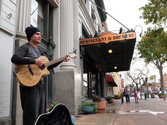 Manuel Laguna plays ballads on Monday in Oldtown Salinas.