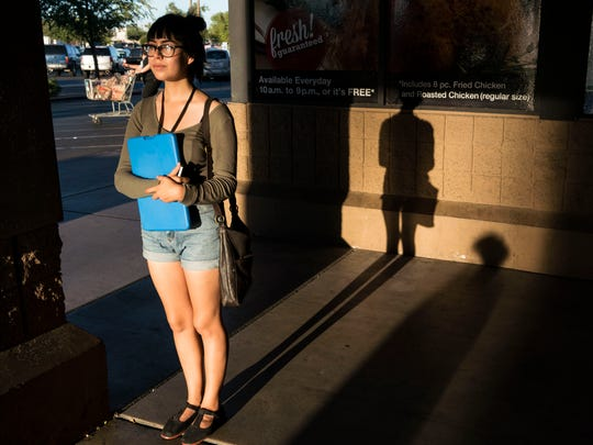 Esther Rivera asks people to register to vote at a Fry's parking lot in Phoenix. She turns 18 on Oct. 23, 16 days before the election.