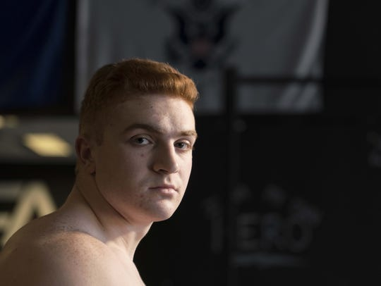 Luke Musselman misses football, but is shining in weightlifting.
