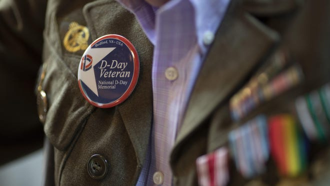97-year-old veteran Lawrence McCauley, wears his military uniform with a button from the National D-Day Memorial at his home in Lewis Center on Thursday, May 28, 2020. In addition to his numerous accolades for his service, McCauley will be honored with the Legion of Honor medal from the French government for his part in the D-Day invasion of Normandy in WWII before going on to help liberate Buchenwald concentration camp in Germany.