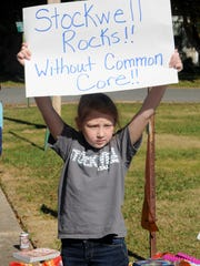 Stockwell 2nd grader student Aubrey Jeane protests