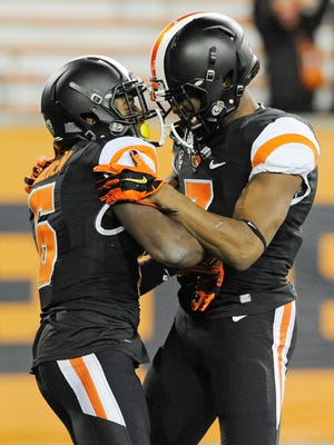 Victor Bolden, left, celebrates his third-quarter TD catch with Hunter Jarmon.