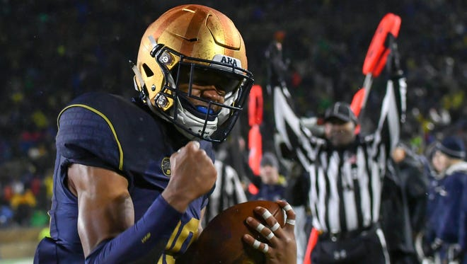Notre Dame Fighting Irish wide receiver Kevin Stepherson (29) celebrates after scoring a touchdown in the fourth quarter against the Navy Midshipmen at Notre Dame Stadium.