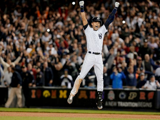 Yankees' Derek Jeter jumps after hitting the game-winning single against the Orioles in his final game at Yankee Stadium. (AP Photo/Julie Jacobson, File)