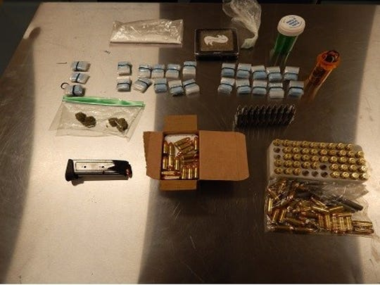 Police found heroin and other drugs, as well as ammunition.