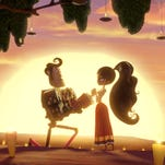"""Manolo, voiced by Diego Luna, and Maria, voiced by Zoe Saldana, court in Mexico in """"The Book of Life."""""""