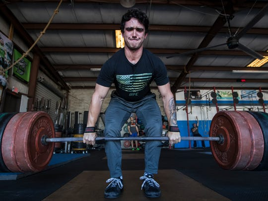 Tyler Giuliano, a coach at Crossfit Cape Coral, works