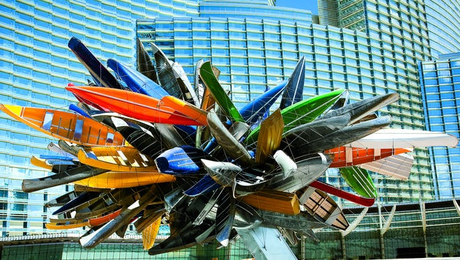 Nancy Rubins' Big Edge outside the Vdara Hotel and Spa is a colorful composition of aluminum row boats and canoes in a gravity-defying sculpture.