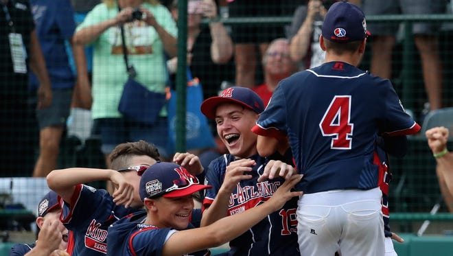Pitcher Ryan Harlost, No. 19,  is mobbed by teammates after getting the last out for a 2-1 win over the Asia-Pacific team from South Korea to win the Little League World Series Championship Game at Lamade Stadium on Sunday in South Williamsport, Pennsylvania.