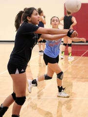 Tularosa senior Reagan Brusuelas keeps a ball alive during a rally at practice Tuesday afternoon.