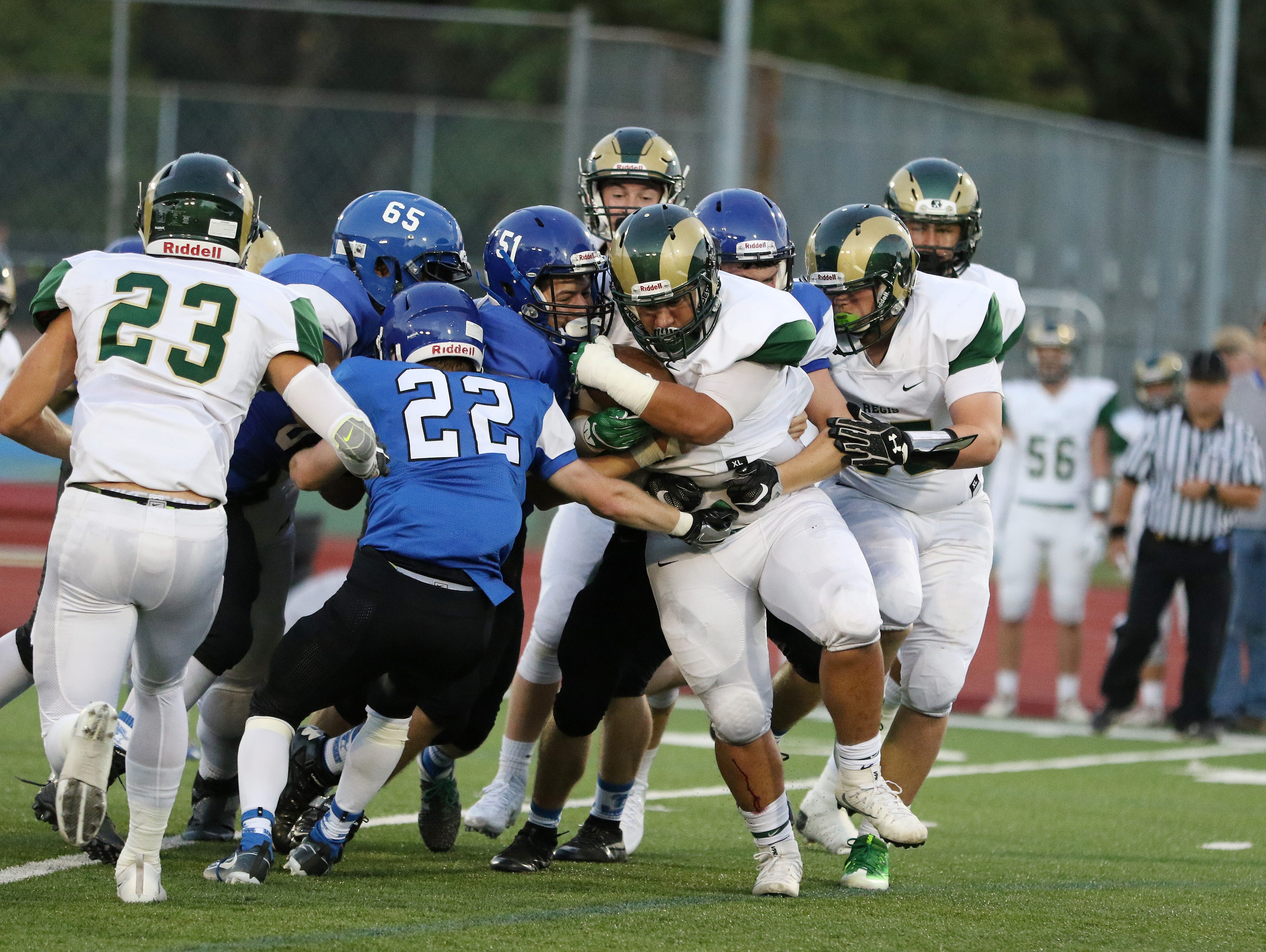 Blanchet defenders surround Regis's Adair Pelayo during a game on Friday, Sept. 2, 2016, at McCulloch Stadium in Salem.