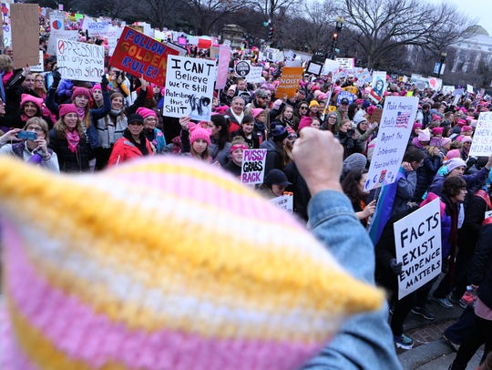 Marchers make their way towards the White House during